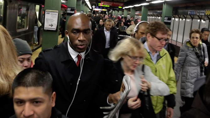 "In this photo taken March 14, 2013, morning commuters fill the platform as they exit a train in New York's Times Square subway station. An historic decline in the number of U.S. whites and the fast growth of Latinos are blurring traditional black-white color lines, testing the limits of civil rights laws and reshaping political alliances as ""whiteness"" begins to lose its numerical dominance. The demographic shift is now a potent backdrop to an immigration overhaul bill being debated in Congress that could offer a path to citizenship for 11 million mostly Hispanic illegal immigrants.  (AP Photo/Richard Drew)"