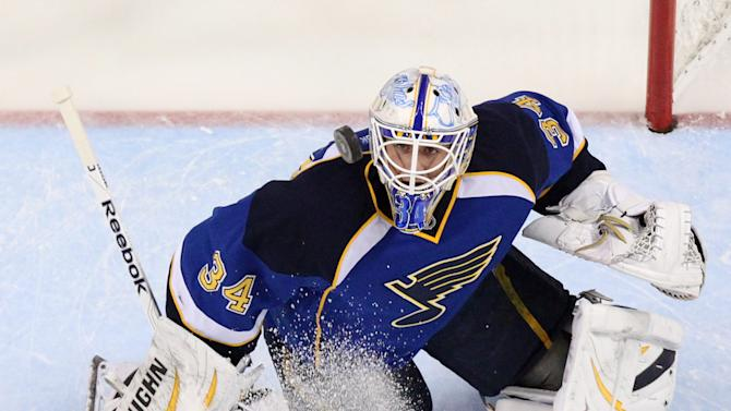 Blues goaltender Jake Allen tracks the puck in third period action during a game between the St. Louis Blues and the San Jose Sharks on Tuesday, March 12, 2013, at the Scottrade Center in St. Louis. (AP Photo/ St. Louis Post-Dispatch, Chris Lee)