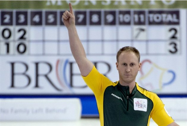 Skip Brad Jacobs celebrates scoring at the Tim Hortons Brier in Edmonton on March 10, 2013. Despite a lack of experience, Jacobs enters the world men's curling championships as the favourite. THE CANA