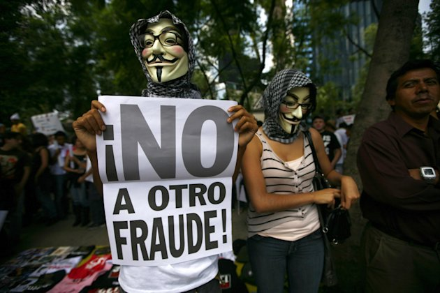 Wearng a Guy Fawkes mask, a Mexican unhappy with the presidential election results, holds a banner that reads in Spanish; &quot;No to another fraud!,&quot; during a march in Mexico City, Saturday, July 7, 2012. The protestors are marching in rejection of the final count in the presidential election showing former ruling party candidate Enrique Pena Nieto as the victor. They believe the PRI engaged in vote-buying that illegally tilted millions of votes. PRI officials deny the charge. (AP Photo/Marco Ugarte)