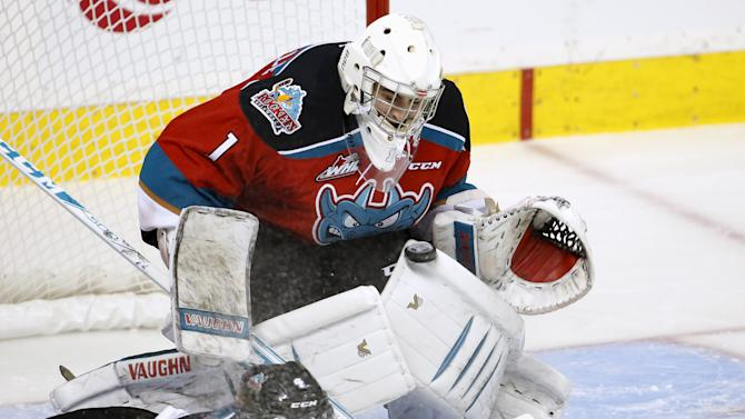 Kelowna Rockets goalie Jackson Whistle makes a save against the Rimouski Oceanics during the overtime period of their Memorial Cup hockey game at the Colisee Pepsi in Quebec City