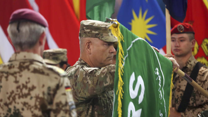 "Commander of the International Security Assistance Force (ISAF), Gen. John Campbell, opens the ""Resolute Support"" flag during a ceremony at the ISAF headquarters in Kabul, Afghanistan, Sunday, Dec. 28, 2014. The United States and NATO formally ended their war in Afghanistan on Sunday with the ceremony at their military headquarters in Kabul as the insurgency they fought for 13 years remains as ferocious and deadly as at any time since the 2001 invasion that unseated the Taliban regime following the Sept. 11 attacks. (AP Photo/Massoud Hossaini)"