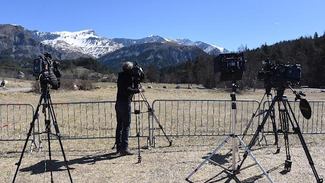 A cameraman in Vernet in the French Alps on April 1, 2015, films the mountains where the Germanwings flight 4U 9525 crashed