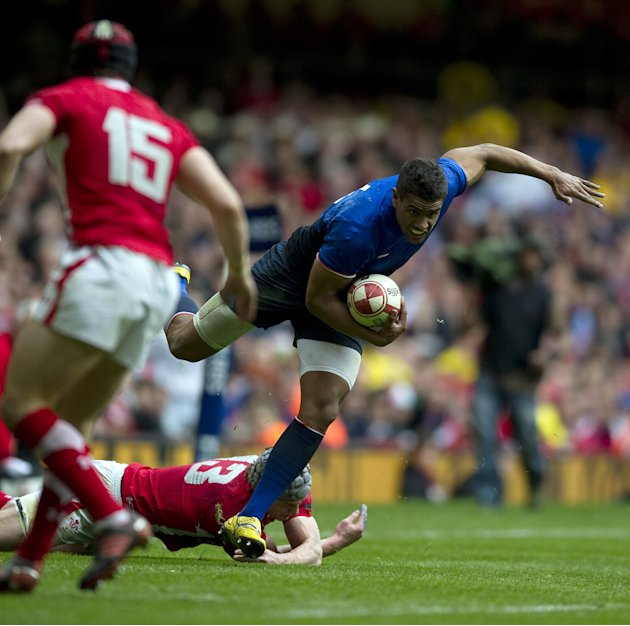 France wing Wesley Fofana (R) is tackled by Wales' centre Jonathan Davies (2nd R) during the Six Nations International rugby union match between Wales and France at the Millennium Stadium in Cardiff,