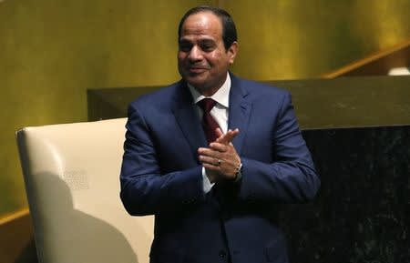 Egypt's President Abdel Fattah al-Sisi acknowledges applause as he takes the stage before his address to the 69th United Nations General Assembly at U.N. headquarters in New York