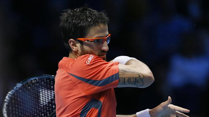 Janko Tipsarevic of Serbia plays a return to Roger Federer of Switzerland during their singles tennis match at the ATP World Tour Finals in London Tuesday, Nov. 6, 2012. (AP Photo/Kirsty Wigglesworth)