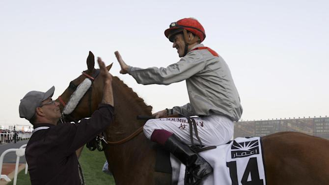 Jockey Christophe Soumillon on Al Mamun Monalau from France celebrates after they won the Dubai Kahayla Classic at Meydan racecourse in Dubai, United Arab Emirates, Saturday, March 30, 2013. (AP Photo/Kamran Jebreili)