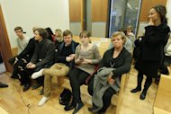 Unidentified victims and their legal counsel wait in the court house in Oslo Monday Nov. 14, 2011 before the hearing for Anders Behring Breivik. They are in a different room of the court to where Breivik will appear and will follow proceedings on a big screen. Breivik has admitted killing 77 people on July 22. (AP Photo/Scanpix, Heiko Junge) NORWAY OUT