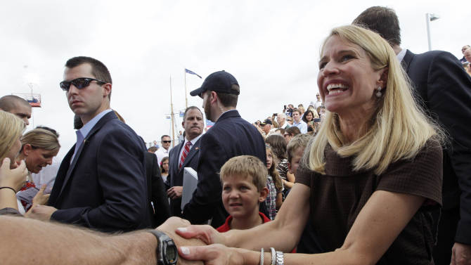 FILE - In this Aug. 11, 2012 file photo, Janna Ryan, wife of Republican Vice Presidential candidate, Rep. Paul Ryan, R-Wis., partially visible behind her, greets crowd members in Norfolk, Va. Like her husband, Janna Ryan is a Washington veteran as a legislative staffer, attorney and lobbyist. Now a stay-at-home mom, she comes from a family rooted deep in Oklahoma politics.  (AP Photo/Mary Altaffer, File )