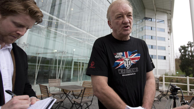 David Cundell project leader of the archaeological attempt to dig up and recover a number of British World War II Spitfire Mark XIV fighter planes, buried in Myanmar at the end of the WWII, as they speak to members of the media during a briefing on how they intend to discover the aircraft, at a hotel near London's Heathrow Airport, Friday, Jan. 4, 2013. The iconic Battle of Britain Spitfires according to records were crated, stored and then buried rather than ship them back to Britain, at various locations around Myanmar as British forces left the country following the defeat of Japan at the end of WWII.  The group leave to Myanmar Saturday Jan 5.  (AP Photo/Alastair Grant)