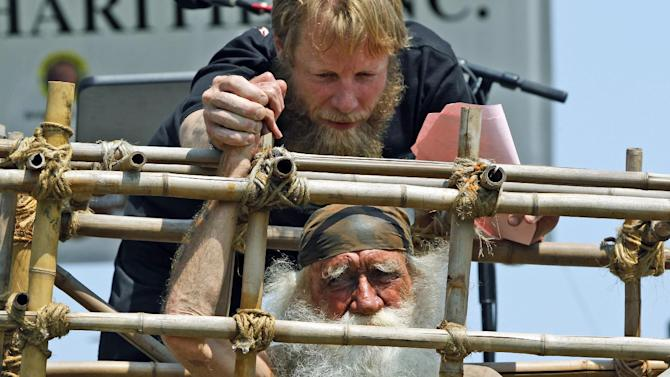 Bob Bergdahl, father of Army Sgt. Bowe Bergdahl of Hailey, Idaho, who is being held captive in Afghanistan, shakes the hand of Gerald McCullar of Washington, Ill., who is portraying a prisoner of war, after he speaks at the the annual Rolling Thunder rally for POW/MIA awareness, in Washington, Sunday, May 27, 2012. (AP Photo/Charles Dharapak)