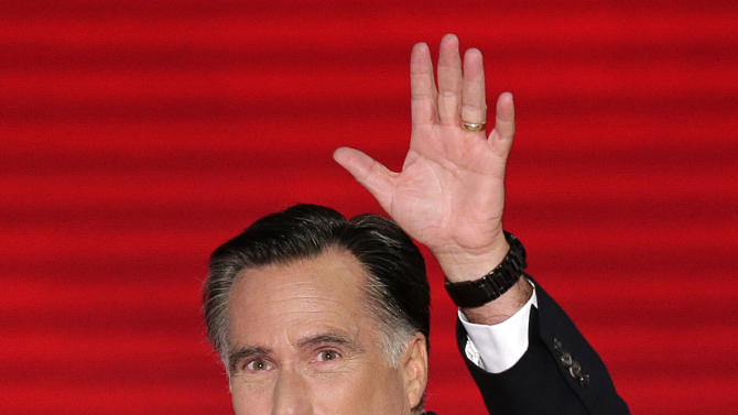 Republican presidential nominee Mitt Romney waves to the delegates as he walks to the stage during the Republican National Convention in Tampa, Fla., on Thursday, Aug. 30, 2012. (AP Photo/J. Scott Applewhite)