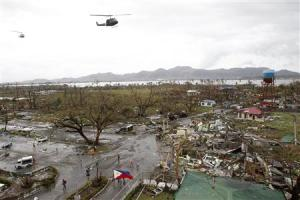 Helicopters hover over the damaged area after super …