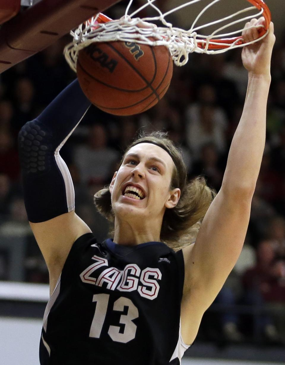 FILE - In this Jan. 5, 2013 file photo, Gonzaga's Kelly Olynyk scores against Santa Clara in the first half of an NCAA college basketball game in Santa Clara, Calif. Olynyk is a possible first round pick in the NBA Draft on June 27. (AP Photo/Ben Margot, File)