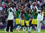 Senegal&#39;s players celebrate after winning their football match against Uruguay during the 2012 London Olympic Games at Wembley Stadium in London. Senegal won 2-0