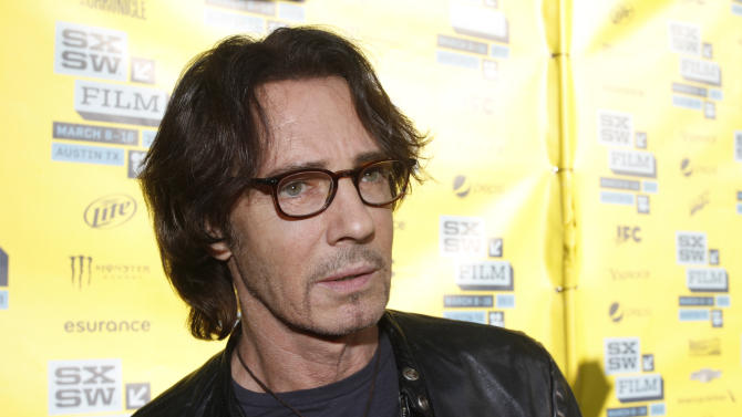 """FILE - This March 13, 2013 file photo shows actor-singer Rick Springfield at a screening of his movie """"Sound City"""" during the SXSW Film and Music Festival, in Austin, Texas. Springfield will publish his debut novel, """"Magnificent Vibration"""" scheduled for publication in May 2014. (Photo by Jack Plunkett/Invision/AP, file)"""