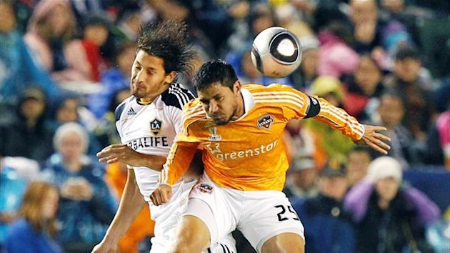 LA Galaxy defender Omar Gonzalez battles Houston Dynamo forward Brian Ching for a header (Reuters)