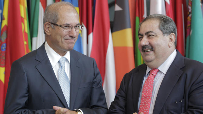 Ahmet Uzumcu, director general of the Organisation for the Prohibition of Chemical Weapons (OPCW), left, and Iraqi Foreign Minister Hoshyar Zebari, right, pose for photographers after a press conference in The Hague Wednesday Sept. 7, 2011. Uzumcu, the chief of a U.N. watchdog said Libyan stockpiles are believed to be secure despite the turmoil that has roiled the country since February. (AP Photo/Peter Dejong)
