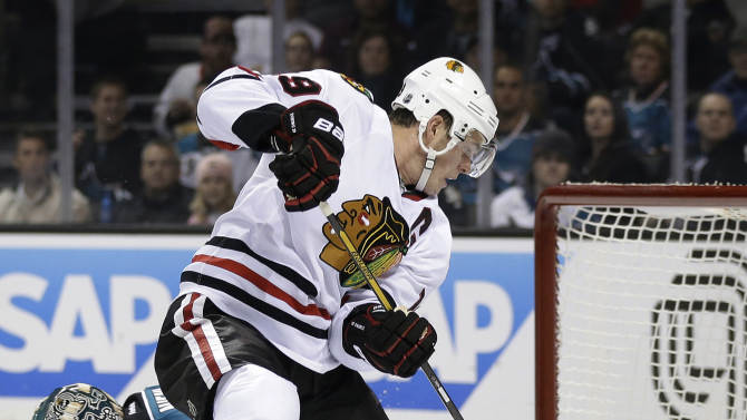 Chicago Blackhawks center Jonathan Toews, right, collides with San Jose Sharks goalie Antti Niemi, of Finland, during the first period of an NHL hockey game in San Jose, Calif., Tuesday, Feb. 5, 2013. (AP Photo/Marcio Jose Sanchez)