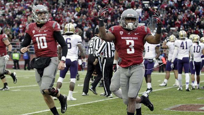 Washington State's Carl Winston (3) reacts with quarterback Jeff Tuel (10) after scoring his third touchdown of an NCAA college football game against Washingon, Friday, Nov. 23, 2012, in Pullman, Wash. Washington State went on to best Washington 31-28 in overtime. (AP Photo/Ted S. Warren)