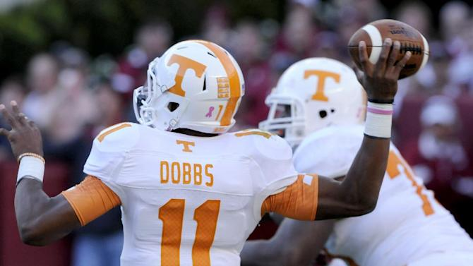 In this Oct. 26, 2013, photo Tennessee quarterback Josh Dobbs passes against Alabama during a NCAA football game in Tuscaloosa, Ala
