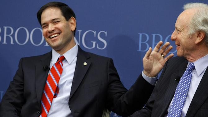 Senate Foreign Relations Committee member Sen. Marco Rubio, R-Fla., left, jokes with Sen. Joseph Lieberman, I-Conn., before Rubio spoke about foreign policy at the Brookings Institution, in Washington, Wednesday, April 25, 2012. (AP Photo/Jacquelyn Martin)