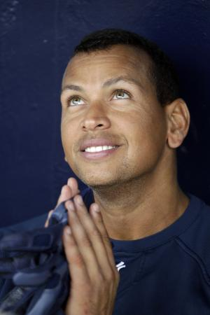 New York Yankees' Alex Rodriguez gestures as he talks with a reporter during practice at baseball spring training, Saturday, Feb. 25, 2012, in Tampa, Fla. (AP Photo/Matt Slocum)