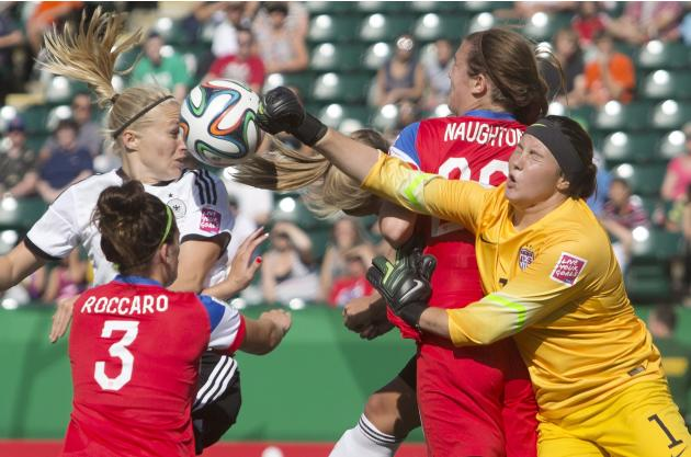 USA goalkeeper Katelyn Rowland (1) makes the save on Germany's Pauline Bremer as Cari Roccaro (3) and Katie Naughton (20) defend during the first half of a FIFA U-20 women's World Cup soccer m