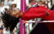 United States&#39;  Brigetta Barrett competes in a women&#39;s high jump qualification round during the athletics in the Olympic Stadium at the 2012 Summer Olympics, London, Thursday, Aug. 9, 2012. (AP Photo/Matt Dunham)