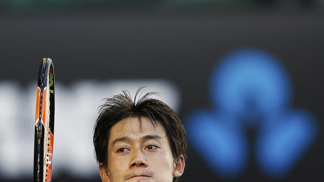 Nishikori of Japan celebrates defeating Ferrer of Spain in their men's singles fourth round match at the Australian Open 2015 tennis tournament in Melbourne