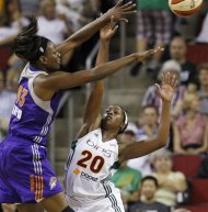Seattle Storm's Camille Little (20) defends as Phoenix Mercury's Nakia Sanford gets off the pass in the first half of a WNBA basketball game, Thursday, Aug. 16, 2012, in Seattle. (AP Photo/Elaine Thompson)