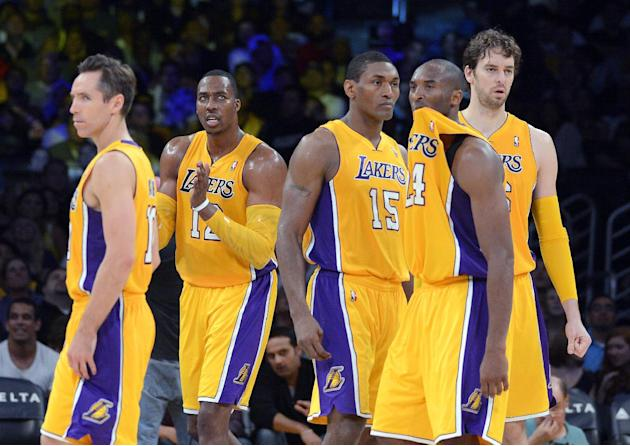 In this Oct. 21, 2012, file photo, Los Angeles Lakers, from left, Steve Nash, Dwight Howard, Metta World Peace, Kobe Bryant and Pau Gasol, of Spain, pause during the second half of a preseason NBA bas