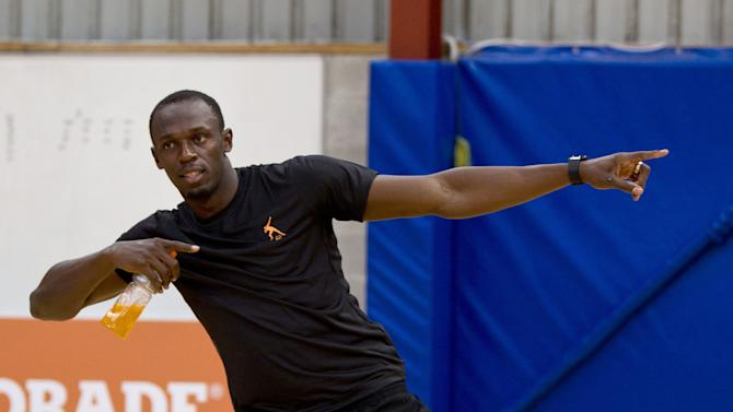 London Olympics champion Usain Bolt does a traditional challenge dance during the Breakers' basketball team event at their training facility at Mairangi Bay in Auckland, New Zealand, Monday, Oct 8, 2012. The legendary Jamaican sprinter is making a short visit to New Zealand after holidaying in Australia. (AP Photo/New Zealand Herald, Dean Purcell) NEW ZEALAND OUT, AUSTRALIA OUT