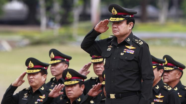 Thailand's newly appointed Prime Minister Prayuth Chan-ocha reviews honor guards during his visit at the 2nd Infantry Battalion, 21st Infantry Regiment, Queen's Guard in Chonburi province