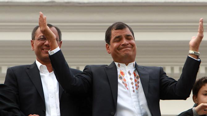 Ecuador's President and candidate for re-election Rafael Correa, top right, and vice presidential candidate Jorge Glass, top left, accompanied by relatives, celebrate after presidential elections in Quito, Ecuador, Sunday, Feb. 17, 2013. Although official results had still not been released, Correa celebrated his second re-election as Ecuador's president after an exit poll showed him leading by a wide margin. (AP Photo/Martin Jaramillo)