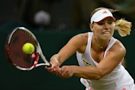 Germany's Angelique Kerber plays a shot during her women's singles quarter-final victory over Germany's Sabine Lisicki on day eight of the 2012 Wimbledon Championships tennis tournament at the All England Tennis Club in Wimbledon, southwest London. Kerber won the match