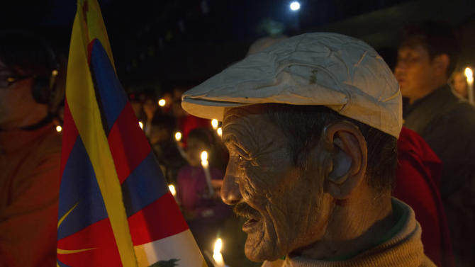 Tibetan exiles participate in a candlelit vigil in Dharmsala, India, Monday, Oct. 22, 2012 for a Tibetan man named Dhondup, who is believed to have died after self-immolating Monday at the remote Labrang Monastery in China's northwestern Gansu province. Dozens of Tibetans have set themselves on fire since March 2011 in ethnic Tibetan areas of China in protest over what activists say is Beijing's heavy-handed rule in the region. (AP Photo/Ashwini Bhatia)