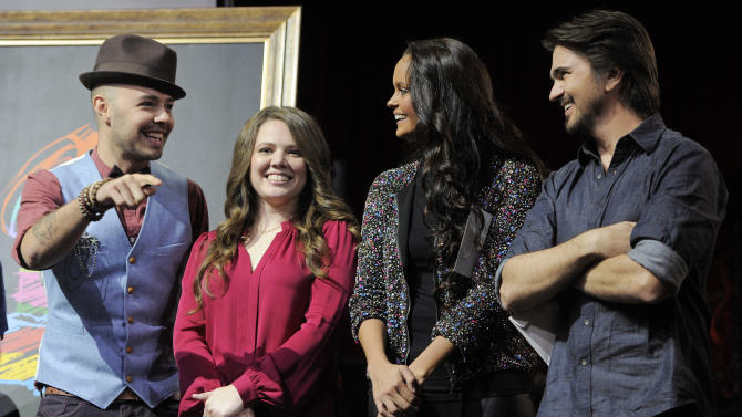 Colombian musician Juanes, right, mingles with fellow musical artists, from left, Jesse & Joy of Mexico and Shaila Durcal of Spain at The XIII Annual Latin Grammy Awards nominations at the Belasco Theater on Tuesday, Sept. 25, 2012, in Los Angeles. The show will be held on Nov. 15 in Las Vegas. (Photo by Chris Pizzello/Invision/AP)