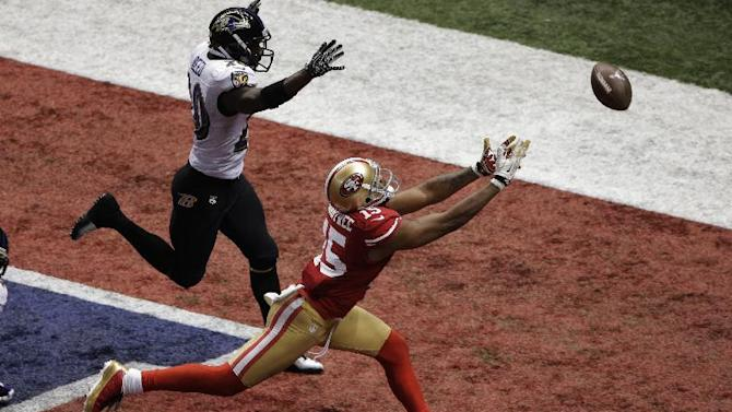 San Francisco 49ers wide receiver Michael Crabtree (15) cannot reach a pass thrown on fourth-and-goal as Baltimore Ravens safety Ed Reed (20) defends late in the fourth quarter of the NFL Super Bowl XLVII football game, Sunday, Feb. 3, 2013, in New Orleans. (AP Photo/Charlie Riedel)