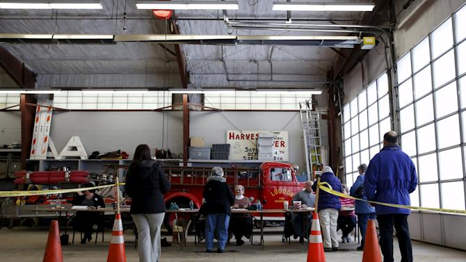 People sign in to vote at the Loudon Fire Department polling place in Loudon, New Hampshire