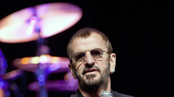 """FILE - This June 1, 2011 file photo shows British musician Ringo Starr in Dunsfold, England. Starr will release """"Photograph,"""" a collection of photos taken by Ringo and exclusive images from his personal archives. The material will first be published as an ebook, available exclusively on the iBookstore, on June 12, 2013, in conjunction with the Grammy Museum Exhibit, """"Ringo: Peace & Love"""". (AP Photo/Joel Ryan, file)"""