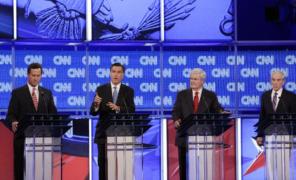 Republican presidential candidates, former Pennsylvania Sen. Rick Santorum, former Massachusetts Gov. Mitt Romney, former House Speaker Newt Gingrich and Rep. Ron Paul, R-Texas, participate in the Republican presidential candidate debate at the North Charleston Coliseum in Charleston, S.C., Thursday, Jan. 19, 2012. (AP Photo/David Goldman)
