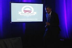 U.S. President Obama takes the stage to deliver remarks on Obamacare at an Organizing for Action grassroots supporter event in Washington