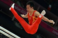 China's gymnast Chen Yibing competes on the parrallel bars during the men's qualification of the artistic gymnastics event of the London Olympic Games. The United States, Russia and hosts Great Britain exploited sloppiness from Japan and defending Olympic champions China to set the pace in men's artistic gymnastics qualifying on Saturday
