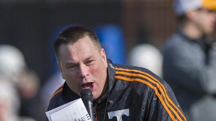 Tennessee head coach Butch Jones yells to his squad during spring practice Saturday, March 8, 2014, in Knoxville, Tenn. Jones has not set a timetable on when he will choose a starting quarterback. Jones said he'd decide on a starter whenever someone emerges as the clear-cut choice