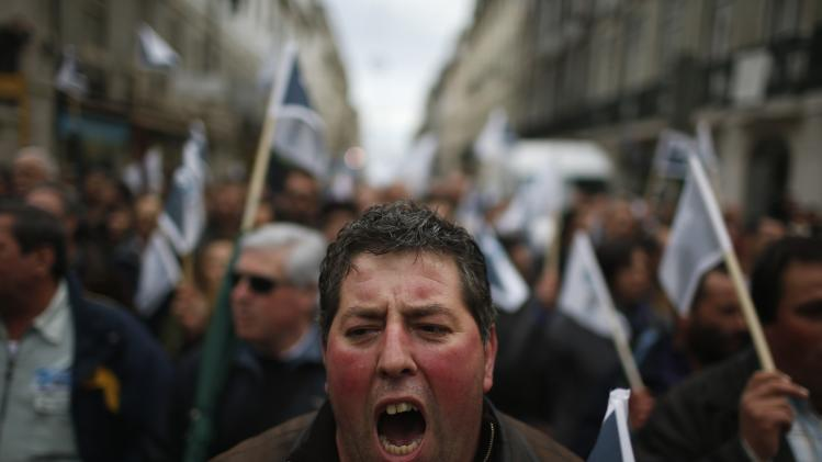 Demonstrators shout slogans during a march towards the official residence of the Prime Minister at Sao Bento Palace in Lisbon