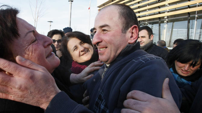 Relatives hug a former prisoner as he leaves Gldani prison No. 8 in Tbilisi, Georgia, Sunday, Jan. 13, 2013. Nearly 200 inmates considered political prisoners by Georgia's new parliament have walked free under an amnesty strongly opposed by President Mikhail Saakashvili. Many of those who walked free on Sunday were arrested during anti-Saakashvili protests in May 2011. Others had been convicted of trying to overthrow the government or of spying for Russia. (AP Photo) Shakh Aivazov