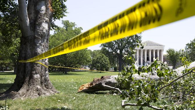 FILE - In this June 30, 2012, file photo, an American Beech tree is down on Capitol Hill grounds in Washington across from the U.S. Supreme Court after a powerful storm swept across the Washington region. A gigantic line of powerful thunderstorms with tree-toppling winds is likely to threaten one in five Americans Wednesday is as it rumbles from Iowa to Maryland, meteorologists warn. The massive storms may even spawn an unusual weather event called a derecho, which is a massive storm of strong straight-line winds spanning at least 240 miles. (AP Photo/Manuel Balce Ceneta, File)