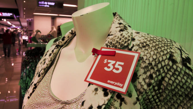 """In this June 8, 2012 photo, a red """"everyday"""" pricing tag is attached to clothes on display at a J.C. Penney store in New York. Six months after J.C. Penney got rid of the hundreds of sales it offers each year in favor of a three-tier pricing approach, the mid-priced department store chain is revamping its pricing strategy again. (AP Photo/Bebeto Matthews)"""