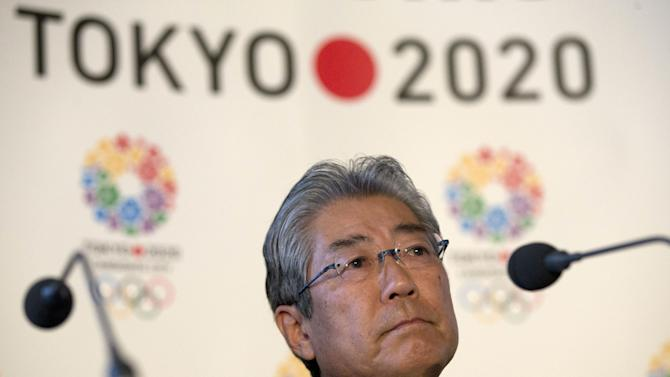 Tsunekazu Takeda, President of the Tokyo 2020 Olympic games bid, listens to a question from the media during their first international presentation of the Tokyo 2020 Olympic Games bid in London, Thursday, Jan. 10, 2013. (AP Photo/Alastair Grant)